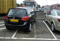 http://www.bentcop.biz/example_of_a_car_in_a_car_park_which_is_not_wholly_parked_within_the_markings_of_the_bay.jpg