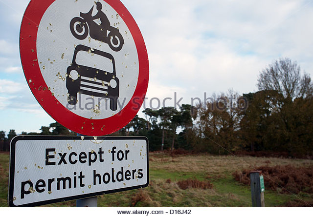 http://www.bentcop.biz/no-motor-vehicles-except-permit-holders-sign-d16j42.jpg